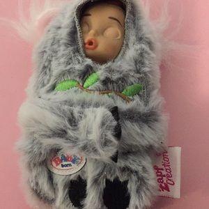 "Baby born in furry snowsuit 5"""